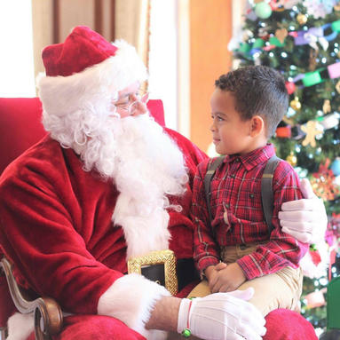 Young boy sitting on Santa's lap at The Inn