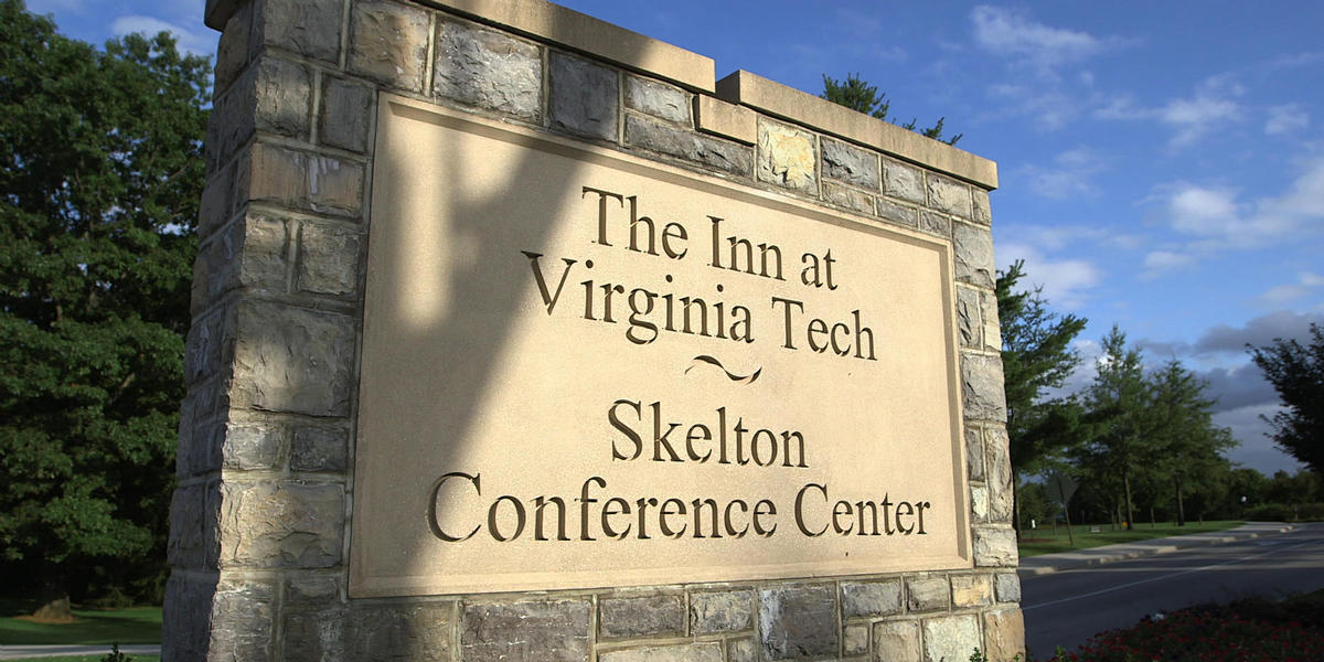 The Inn at Virginia Tech and Skelton Conference Center sign at entrance from Prices Fork Road