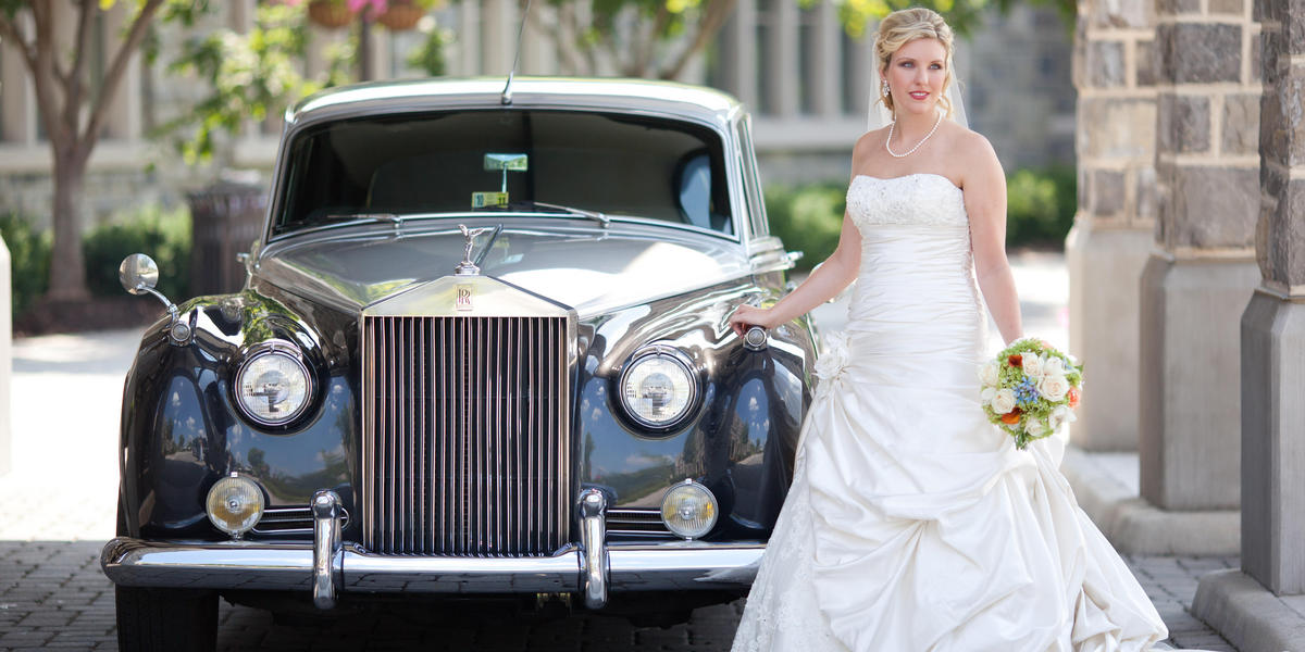 Bride with Rolls Royce car in front of The Inn under the entryway