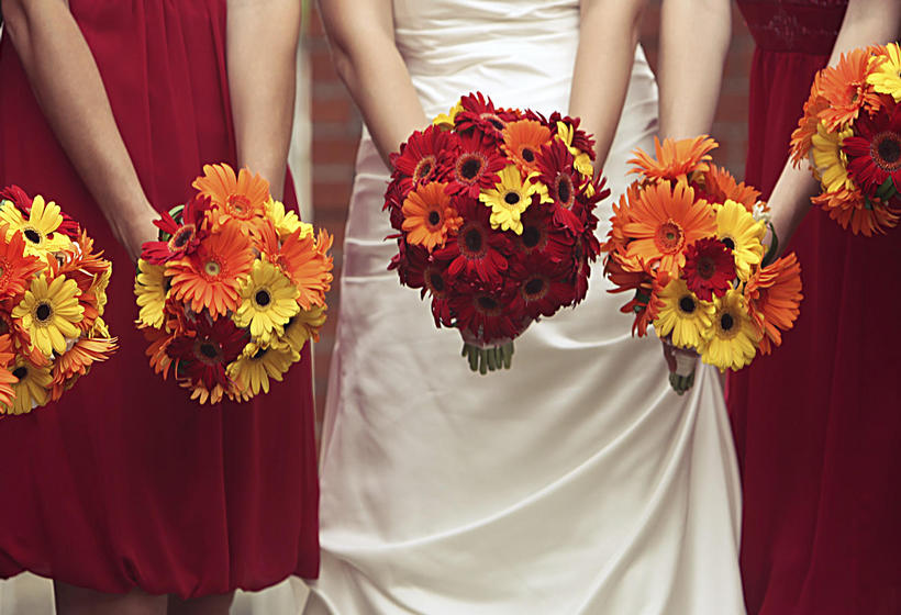 Bride with bridemaids holding floral bouquets